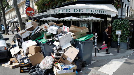 A pile of garbage bags is seen in front of the cafe in Paris during a strike of garbage collectors and sewer workers to protest the labour reforms law proposal, France, June 8, 2016 © Charles Platiau
