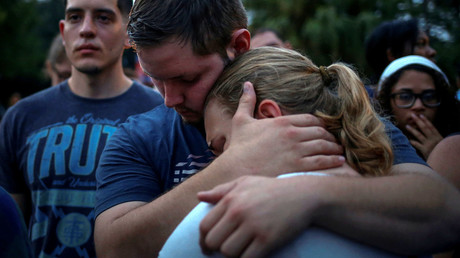 Savannah is embraced by her friend Ricky during a vigil to commemorate victims of a mass shooting at the Pulse gay night club in Orlando, Florida, U.S., June 12, 2016. © Adrees Latif