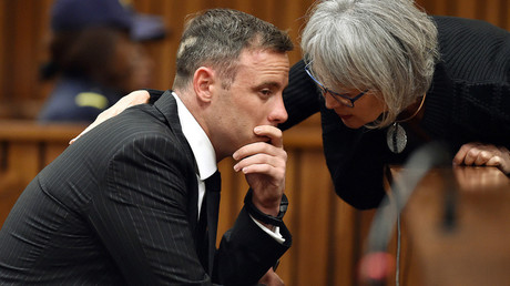 Former Paralympian Oscar Pistorius is comforted by an unidentified woman before his sentencing for the murder of Reeva Steenkamp at the Pretoria High Court, South Africa June 13, 2016. © Phill Magakoe