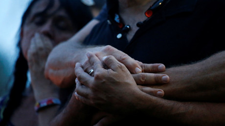 Wilfredo Perez is embraced by his partner Jackson Hollman during a vigil to commemorate victims of a mass shooting at the Pulse gay night club in Orlando, Florida, U.S., June 12, 2016. © Adrees Latif