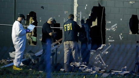 FBI investigators work at the crime scene of a mass shooting at the Pulse gay night club in Orlando, Florida, U.S. June 12, 2016. © Jim Young