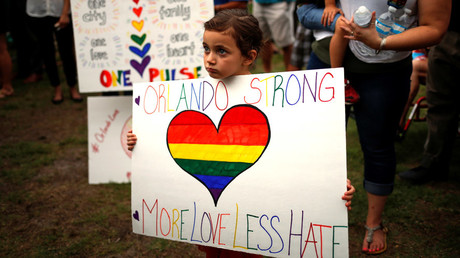 Daily, 5, holds a placard ahead of a candle light vigil in memory of victims one day after a mass shooting at the Pulse gay night club in Orlando, Florida, U.S., June 13, 2016. © Adrees Latif