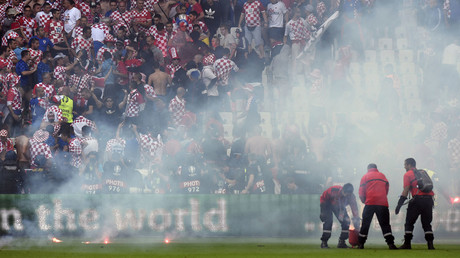 Flares are thrown on the pitch during the Euro 2016 group D football match between Czech Republic and Croatia, June 17, 2016. © Philippe Desmazes
