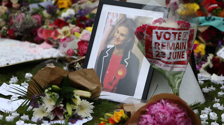 Tributes in memory of murdered Labour Party MP Jo Cox, who was shot dead in Birstall, are left at Parliament Square in London, Britain June 18, 2016. © Neil Hall