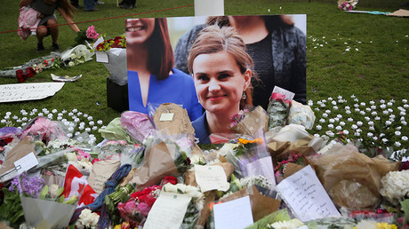Tributes in memory of murdered Labour Party MP Jo Cox, who was shot dead in Birstall, are left at Parliament Square in London, Britain June 18, 2016 © Neil Hall