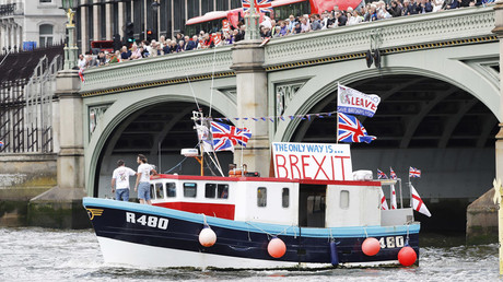 Part of a flotilla of fishing vessels campaigning to leave the European Union sails under Westminster Bridge towards Parliament on the river Thames in London, Britain © Stefan Wermuth