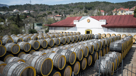 Rows of oak barrels for fermenting Madeira wine at the Massandra wine-making factory. © Mihail Mokrushin