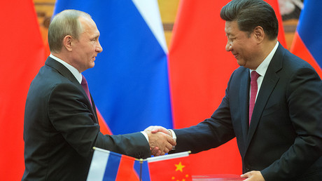 Russian President Vladimir Putin, left, and President of the People's Republic of China Xi Jinping during a signing ceremony of documents following their talks in Beijing © Sergey Guneev