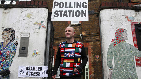 A man wearing a European themed cycling jersey leaves after voting at a polling station for the Referendum on the European Union in north London, Britain, June 23, 2016. © Neil Hall