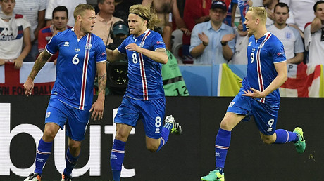 Iceland's players celebrate the team's goal with during Euro 2016 round of 16 match between England and Iceland, June 27, 2016 © AFP