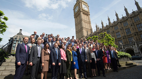 Britain's Prime Minister David Cameron (front row C) poses for a group photograph with Conservative Party MPs, at the Houses of Parliament in London, Britain  © Stefan Rousseau