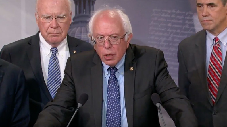 Money tossed on Senate floor as Vermont's Sanders and Leahy protest federal GMO bill