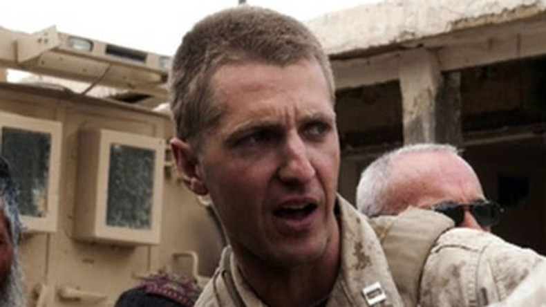 Marine to use Clinton's non-indictment as defense in classified information case