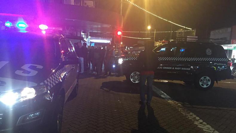 'Deliberate attack': Man sets himself alight, drives car into Sydney police station parking lot