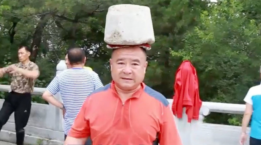 Ready to rock: Chinese man sheds 66lbs by carrying boulder on head (VIDEO)