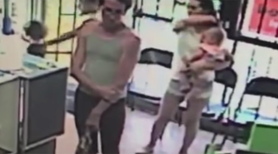 Spine-chilling moment child-snatcher abducts 4yo girl caught on camera (VIDEO)