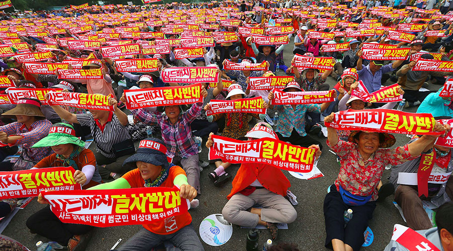 Thousands of S. Koreans protest US missile defense system as Seoul announces location