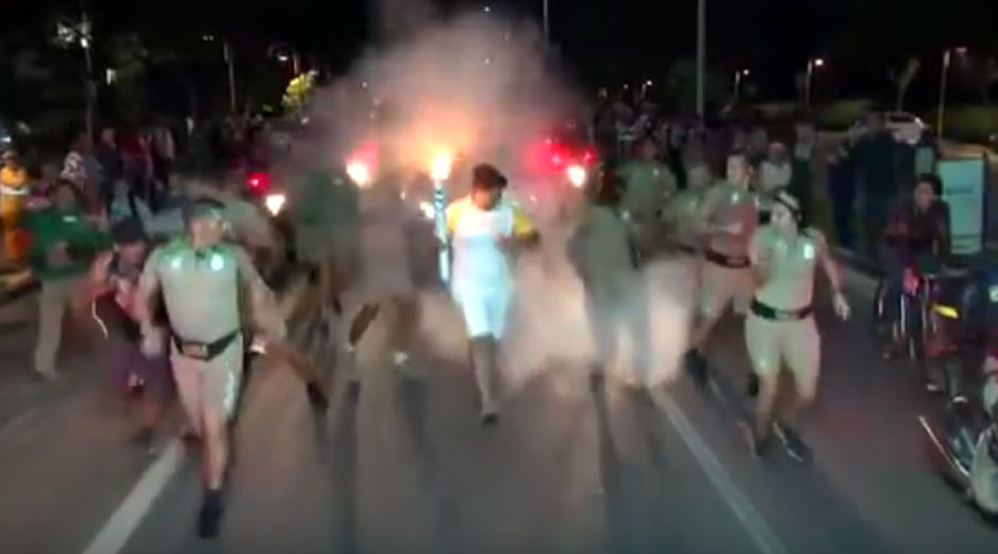 Olympic torch bearer attacked by man with fire extinguisher (VIDEO)