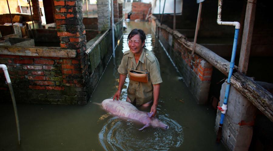 154 killed, 8.6 million affected as extreme rains flood China (PHOTOS)