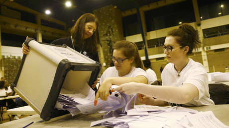 Workers begin counting ballots after polling stations closed in the Referendum on the European Union in Islington, London, Britain, June 23, 2016. © Neil Hall
