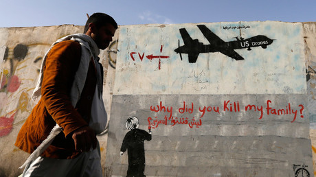 A man walks past a graffiti, denouncing strikes by U.S. drones in Yemen, painted on a wall in Sanaa November 13, 2014. © Khaled Abdullah