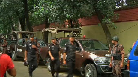 Rapid Action Battalion members walk as police stormed the Holey Artisan restaurant after gunmen attacked it and took hostages early on Saturday in Dhaka, Bangladesh in this still frame taken from live video July 2, 2016. ©