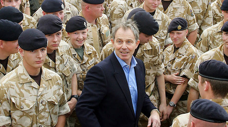 This file photo taken on December 22, 2005 shows British Prime Minister Tony Blair (C) with troops at Shaiba Logistics Base in Basra, Iraq. © Adrian Dennis