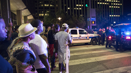 Bystanders stand near pollice baracades following the sniper shooting in Dallas on July 7, 2016. © Laura Buckman
