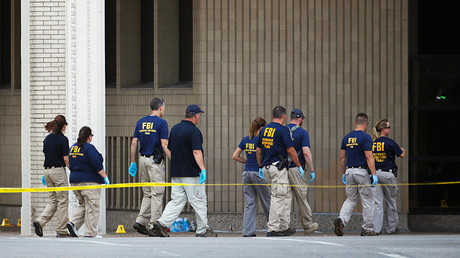FBI investigators look over the crime scene in Dallas, Texas, U.S. July 8, 2016 following a Thursday night shooting incident that killed five police officers © Carlo Allegri