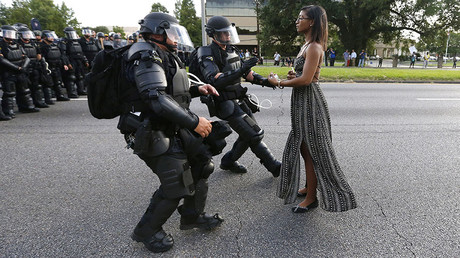 A demonstrator protesting the shooting death of Alton Sterling is detained by law enforcement near the headquarters of the Baton Rouge Police Department in Baton Rouge, Louisiana, U.S. July 9, 2016. © Jonathan Bachman