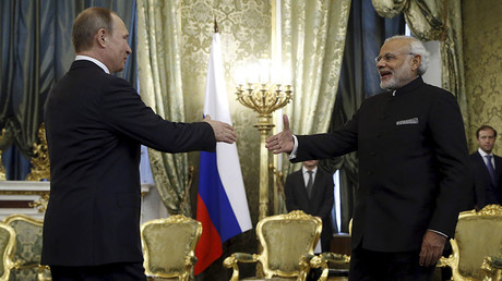 Russia's President Vladimir Putin (L) shakes hands with India's Prime Minister Narendra Modi during a meeting at the Kremlin in Moscow, December 24, 2015. © Maxim Shipenkov