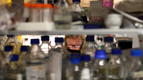 A post-graduate student working in cancer research laboratories at the Old Road Campus research building at Oxford University, in Oxford, Britain. © Peter Nicholls