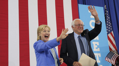 Democratic U.S. presidential candidate Hillary Clinton and Sen. Bernie Sanders stand together during a campaign rally where Sanders endorsed Clinton in Portsmouth, New Hampshire, U.S., July 12, 2016. © Brian Snyder