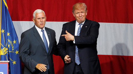 Republican U.S. presidential candidate Donald Trump (R) points to Indiana Governor Mike Pence (L) before addressing the crowd during a campaign stop at the Grand Park Events Center in Westfield, Indiana, July 12,  2016. © John Sommers II