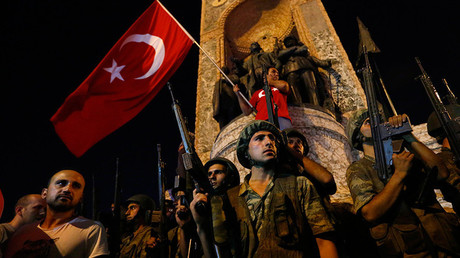 Turkish military stand guard near the the Taksim Square as people wave with Turkish flags in Istanbul. © Murad Sezer
