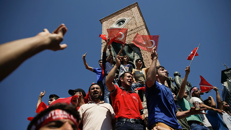 People wave Turkish flags as they stand around the Republic Monument in Taksim Square in Istanbul, Turkey, July 16, 2016 © Alkis Konstantinidis