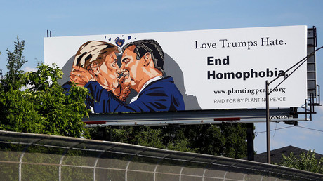 A billboard erected in advance of the Republican National Convention depicts U.S. Republican presidential candidate Donald Trump kissing former presidential candidate Sen. Ted Cruz (R-TX) in Cleveland, Ohio July 15, 2016. © Aaron P. Bernstein