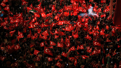 Supporters of Turkish President Tayyip Erdogan wave Turkish national flags during a pro-government demonstration on Taksim square in Istanbul, Turkey, July 18, 2016. © Alkis Konstantinidis