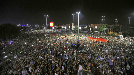 People demonstrate outside Ataturk international airport during an attempted coup in Istanbul, Turkey, July 16, 2016. © Huseyin Aldemir