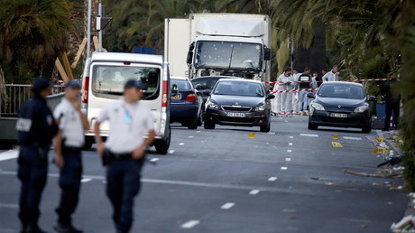 French police continue their investigation as they work near the heavy truck that ran into a crowd at high speed celebrating the Bastille Day July 14 national holiday on the Promenade des Anglais killing 80 people in Nice, France, July 15, 2016. © Eric Gaillard