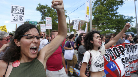 Demonstrators chant slogans during a march by various groups, including