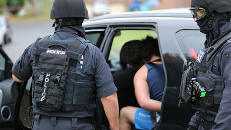 Police arrest a man during a counter-terrorism operation in Sydney. File photo. © AFP