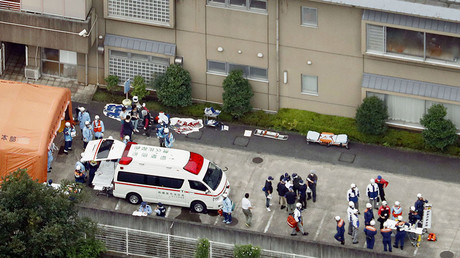 Police officers and rescue workers are seen in a facility for the disabled, where at least 19 people were killed and as many as 20 wounded by a knife-wielding man, in Sagamihara, Kanagawa prefecture, Japan, in this photo taken by Kyodo July 26, 2016. © Kyodo
