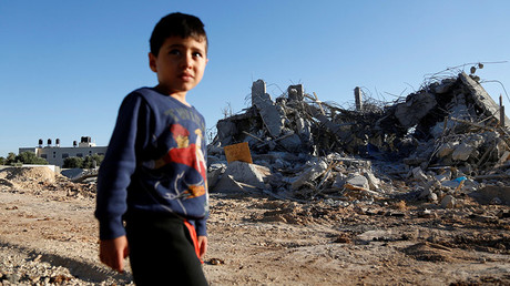 A boy walks past the rubble of a Palestinian house after it was demolished by Israeli troops in the West Bank village of Qalandia near Ramallah July 26, 2016. © Mohamad Torokman