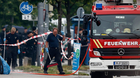 Members of the fire brigade attend the scene near the Olympia shopping mall, in Munich, Germany July 23, 2016. © Michael Dalder