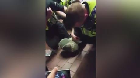 London police filmed pinning down, putting hood on young black man over train station tiff (VIDEO)