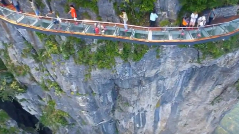 China's terrifying cliffside glass skywalk opens, with 4,600 ft drop below