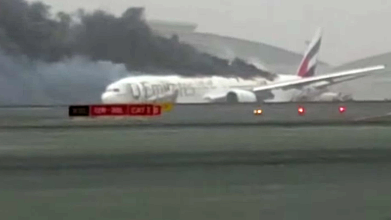 Raw footage shows confusion, fear inside smoke-filled Emirates plane after crash-landing (VIDEO)