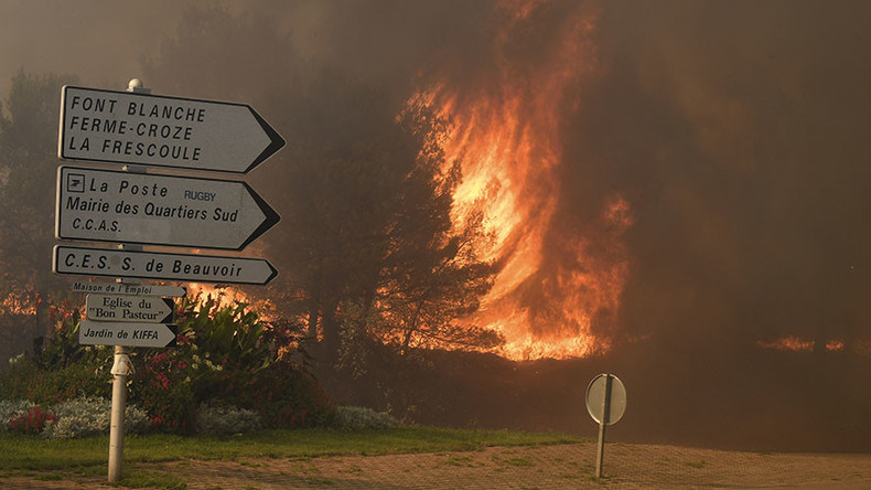 Wildfires rage near Marseille, forcing evacuations & flight diversions (PHOTOS)