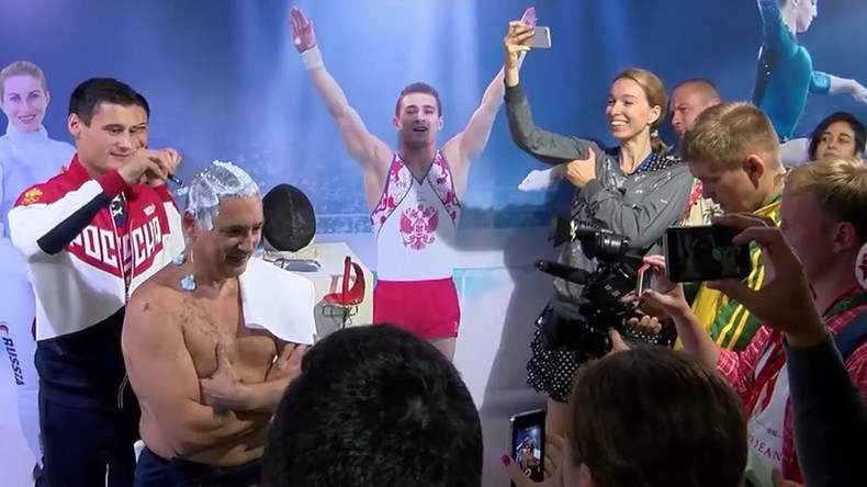 Russian fencing team shaves coach's head clean after scoring 7 medals in Rio (VIDEO)